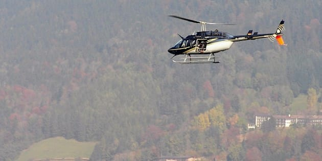 TEGERNSEE, GERMANY - OCTOBER 11:  A helicopter with a film camera crew circles above lake Tegernsee after a canoe carrying three people capsized during the shooting of a made for TV movie on 11 October 2007 in Tegernsee, Germany. Two people were rescued, one remains missing. Cast members Christiane Hoerbiger and Elmar Wepper were not in the canoe and remained unharmed, according to police reports.  (Photo by Andreas Leder/Getty Images)