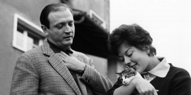 The actress Alba Arnova, holding a cat, and her husband Gianni Ferrio outside their new residence in Rome. Rome, March 1962 (Photo by Mondadori Portfolio via Getty Images)