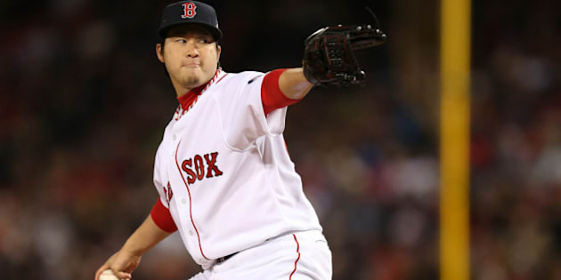 BOSTON, MA - OCTOBER 23:  Junichi Tazawa #36 of the Boston Red Sox pitches against the St. Louis Cardinals in the eighth inning of Game One of the 2013 World Series at Fenway Park on October 23, 2013 in Boston, Massachusetts.  (Photo by Rob Carr/Getty Images)