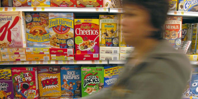 UNITED STATES - SEPTEMBER 21:  A shopper pushes her cart down the cereal aisle, including General Mills cereal Fruity Cheerios, in a New York supermarket Thursday, September 21, 2006. General Mills Inc., the second-largest U.S. cereal maker, said first-quarter profit rose 6 percent, exceeding analysts' estimates on higher sales of new cereals, including Fruity Cheerios, and Yoplait yogurt .  (Photo by Stephanie Kuykendal/Bloomberg via Getty Images)