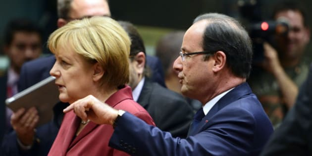 French President Francois Hollande (R) talks on October 24, 2013 with German Chancellor Angela Merkel before the start of a European Council meeting at the EU headquarters in Brussels. European Union heads of state and government open a two-day summit on OCtober 24, focusing notably on prospects for growth from the digital economy amid data privacy concerns, plus lessons from the Lampedusa migrant tragedy. AFP PHOTO / ERIC FEFERBERG        (Photo credit should read ERIC FEFERBERG/AFP/Getty Images)