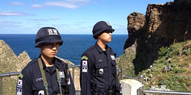 DOKDO ISLAND, SOUTH KOREA - OCTOBER 4: South Korean national police guard the islands in pairs positioned at various lookout points in South Korea on October 4, 2012. 