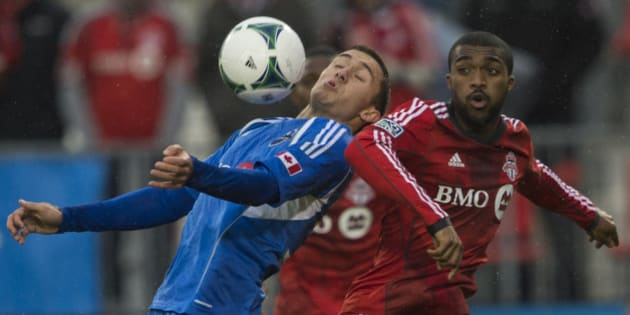 TORONTO - OCTOBER 26 - Montreals Andrew Wenger controls the ball in front of Doneil Henry of TFC. Toronto FC takes on Montreal Impact on October 26, 2013, at BMO Field for the last regular season game this year. TFC has one of the worst winning percentages ever, as they conclude another dismal year.        (Rick Madonik/Toronto Star via Getty Images)