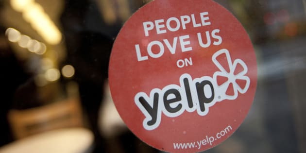 The Yelp Inc. logo is displayed in the window of a restaurant in New York, U.S., on Thursday, March 1, 2012. Yelp Inc., the site that lets users review everything from diners to dentists, is set to price it's IPO tonight and could potentially raise as much as $100 million, which would value the company at about $838 million. Photographer: Scott Eells/Bloomberg via Getty Images