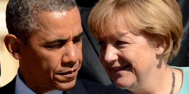 US President Barack Obama (L) stands nearby Germanys Chancellor Angela Merkel during the family picture of the G20 summit in Saint Petersburg on September 6, 2013. World leaders at the G20 summit on Friday failed to bridge their bitter divisions over US plans for military action against the Syrian regime, with Washington signalling that it has given up on securing Russia's support at the UN on the crisis.       AFP PHOTO / KIRILL KUDRYAVTSEV        (Photo credit should read KIRILL KUDRYAVTSEV/AFP/Getty Images)
