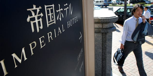 JAPAN - SEPTEMBER 21:  A man walks past a sign outside the Imperial Hotel in Tokyo, Japan, on Friday, Sept. 21, 2007. Mitsui Fudosan Co., Japan's biggest real estate company, may buy a stake in Imperial Hotel Ltd., owner of the 117-year-old hotel, expanding in central Tokyo as commercial land prices advance for the first time since 1991.  (Photo by Robert Gilhooly/Bloomberg via Getty Images)