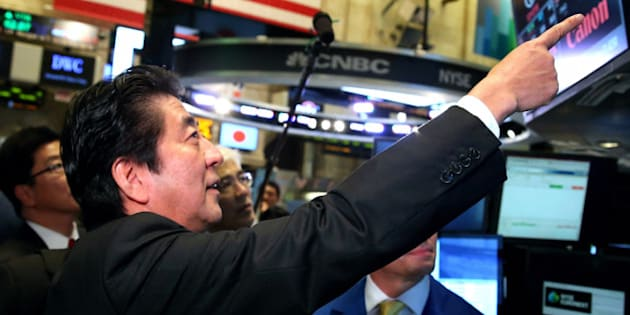 NEW YORK, NY - SEPTEMBER 25:  (CHINA OUT, SOUTH KOREA OUT) Japanese Prime Minister Shinzo Abe visits to the New York Stock Exchange on September 25, 2013 in New York. Abe spoke on 'Abenomics' and Japan's economic recovery.  (Photo by The Asahi Shimbun via Getty Images)