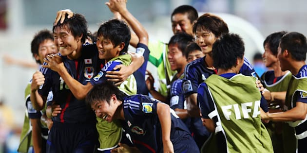 SHARJAH, UNITED ARAB EMIRATES - OCTOBER 24: Daisuke Sakai (front) of Japan celebrates his team's first goal with team mates during the FIFA U-17 World Cup UAE 2013 Group D match between Japan and Tunisia at Sharjah Stadium on October 24, 2013 in Sharjah, United Arab Emirates.  (Photo by Alex Grimm - FIFA/FIFA via Getty Images)