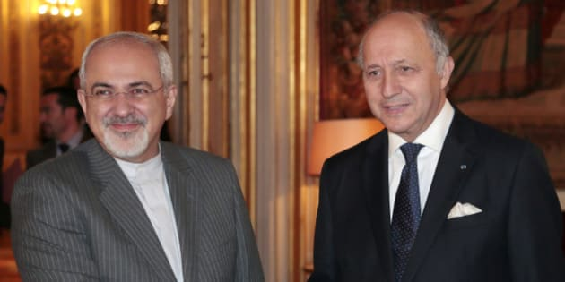 French Foreign Minister Laurent Fabius (R) welcomes his Iranian counterpart Mohammad Javad Zarif at the Quai d'Orsay Foreign ministry on November 5, 2013 in Paris. At the head of the Iranian negotiating team on nuclear matters, Zarif will hold talks on November 7, 2013 in Geneva with representatives of the major powers for a second round of discussions since the election of moderate President Hassan Rohani in June.                         AFP PHOTO / JACQUES DEMARTHON        (Photo credit should read JACQUES DEMARTHON/AFP/Getty Images)