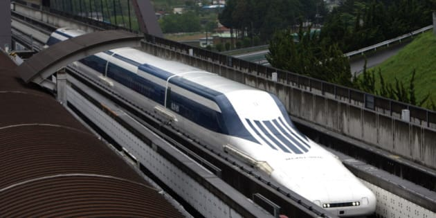 A magnetic-levitation (maglev) train passes at Central Japan Railway Co.'s Yamanashi Maglev test line in Tsuru City, Yamanashi  Prefecture, Japan, on Tuesday, May 11, 2010. U.S. Transportation Secretary Ray LaHood is due to ride a 500 kilometers per hour (311 miles per hour) magnetic-levitation train in Japan today, spurring optimism in the Asian nation about selling such trains in America. Photographer: Tomohiro Ohsumi/Bloomberg via Getty Images