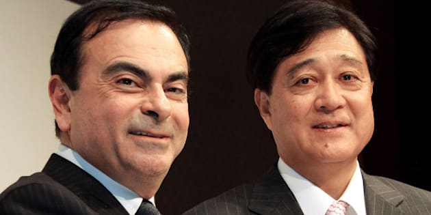 Carlos Ghosn, president and chief executive officer of Nissan Motor Co., left, shakes hands with Osamu Masuko, president of Mitsubishi Motors Corp., during a news conference in Tokyo, Japan, on Tuesday, Dec. 14, 2010. Nissan Motor Co. and Mitsubishi Motors Corp. will set up a 50-50 joint company next year to develop minicars for Japan to help boost sales, expanding an alliance under which the companies supply vehicles to each other. Photographer: Haruyoshi Yamaguchi/Bloomberg via Getty Images ***Local Caption*** Carlos Ghosn, Osamu Masuko