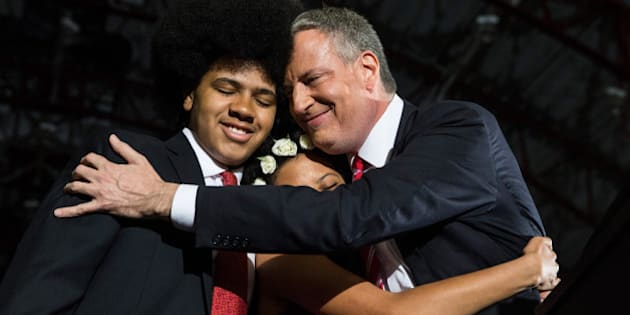 NEW YORK, NY - NOVEMBER 05:  Newly elected New York City Mayor Bill de Blasio (R) hugs his son Dante de Blasio (L) and daughter Chiara de Blasio at his election night party on November 5, 2013 in New York City. De Blasio beat out Republican candidate Joe Lhota and will succeed Michael Bloomberg as the 109th mayor of New York City. He is the first Democratic mayor in 20 years.  (Photo by Andrew Burton/Getty Images)