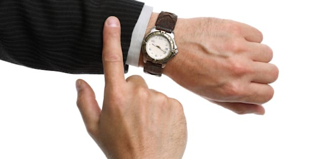 a businessman checking the time ...