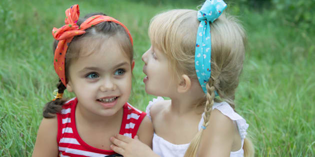 two girls sharing secrets among ...
