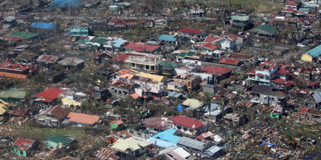 IN AIR, PHILIPPINES - NOVEMBER 10:  In this handout from the Malacanang Photo Bureau, an aerial view of buildings destroyed in the aftermath of Typhoon Haiyan on November 10, 2013 over the Leyte province, Philippines.  Typhoon Haiyan, packing maximum sustained winds of 195 mph (315 kph), slammed into the southern Philippines and left a trail of destruction in multiple provinces, forcing hundreds of thousands to evacuate and making travel by air and land to hard-hit provinces difficult. Around 10,000 people are feared dead in the strongest typhoon to hit the Philippines this year.  (Photo by Ryan Lim/Malacanang Photo Bureau via Getty Images)