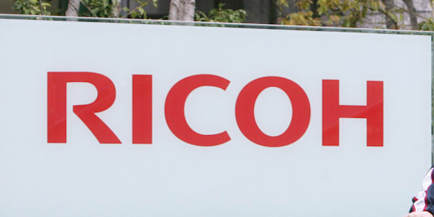 JAPAN - APRIL 18:  A man cycles past the Ricoh Co. headquarters in Tokyo, Japan, on Wednesday, April 19, 2007. Ricoh Co., Japan's second-biggest office equipment maker, said it expects operating profit and sales to rise in the next three years.  (Photo by Tomohiro Ohsumi/Bloomberg via Getty Images)