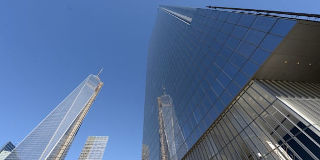 NEW YORK, USA - NOVEMBER 14:  World Trade Center One is seen next to the newly-opened Four World Trade Center on  November 13, 2013 in New York City. 978-foot (298-meter) Four World Trade Center is designed by Japanese architect Fumihiko Maki.  (Photo by Cem Ozdel/Anadolu Agency/Getty Images)