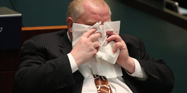 TORONTO, ON- NOVEMBER 14  -   Toronto Mayor Rob Ford wipes his face while in council  at City Hall in Toronto. November 14, 2013.        (Steve Russell/Toronto Star via Getty Images)