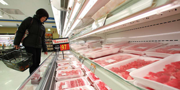 A customer browses packaged U.S. beef at a Seiyu GK supermarket in Tokyo, Japan, on Friday, Feb. 1, 2013. Japan, the biggest buyer of American beef before an outbreak of mad-cow disease in 2003, will allow imports of beef from cattle up to 30-months old, from 20 months previously. Photographer: Junko Kimura/Bloomberg via Getty Images