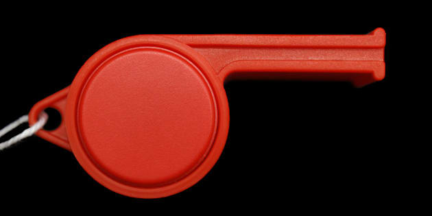 red whistle isolated on black