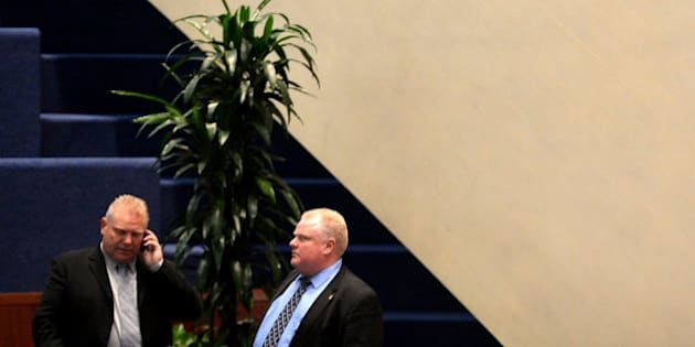 TORONTO, ON - NOVEMBER 15  -  Toronto City Councillor Doug Ford stands with his brother Toronto Mayor Rob Ford during a city hall meeting November 15, 2013.        (Carlos Osorio/Toronto Star via Getty Images)