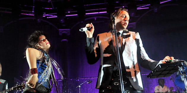 LONDON, ENGLAND - NOVEMBER 11:  Win Butler and  Regine Chassagne of Arcade Fire perform live on stage, during a tour billed under the name 'The Reflektors', at The Roundhouse on November 11, 2013 in London, England.  (Photo by Jim Dyson/Getty Images)