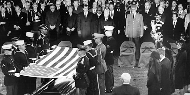 381091 61: Honor guard place a flag over the casket of President John F. Kennedy during his funeral service November 25, 1963 in Arlington Cemetery. (Photo by National Archive/Newsmakers)