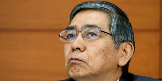 Haruhiko Kuroda, governor of the Bank of Japan (BOJ), listens during a news conference at the central bank's headquarters in Tokyo, Japan, on Thursday, Nov. 21, 2013. The Bank of Japan will alter a target of 2 percent inflation in two years as unprecedented bond-buying proves insufficient to achieve the goal, economists forecast in a Bloomberg News survey. Photographer: Haruyoshi Yamaguchi/Bloomberg via Getty Images