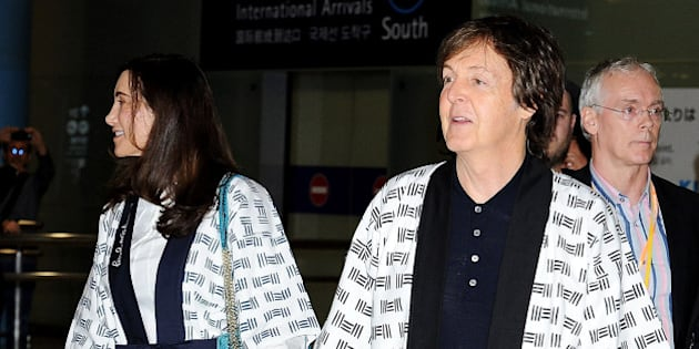 IZUMISANO, JAPAN - NOVEMBER 09:  Sir Paul McCartney and Nancy Shevell together arrive  at Kansai International Airport on November 9, 2013 in Izumisano, Japan.  (Photo by Jun Sato/WireImage)