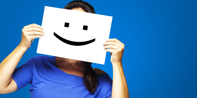 woman showing a happy emoticon...