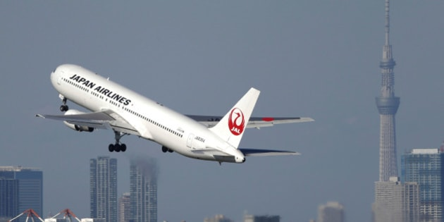 A Japan Airlines Co. (JAL) aircraft takes off from Haneda Airport while the Tokyo Sky Tree, right, stands in Tokyo, Japan, on Sunday, Oct. 27, 2013. JAL is scheduled to report second-quarter earnings on Oct. 31. Photographer: Kiyoshi Ota/Bloomberg via Getty Images