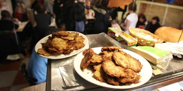 December 4, 2010 Latkes await distribution to the deli for judging. Caplansky's Deli hosts the second Round of their Bubbie Battle: Latkepalooza. Six teams cooked their best potato pancakes in the restaurant at the Hanukah event. Contestants brought a huge amount of Latkes in, every one in the deli had the opportunity to taste and judge. in Toronto. STEVE RUSSELL for the TORONTO STAR (Photo by Steve Russell/Toronto Star via Getty Images)