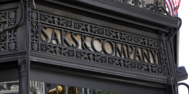 An ironwork logo adorns the facade of Saks flagship store on New York's Fifth Avenue,  Monday, July 29, 2013. Saks Inc. agreed to sell itself to Hudson's Bay Co., the Canadian parent of upscale retailer Lord & Taylor, for about $2.4 billion in a deal that will bring luxury to more North American locales. (AP Photo/Richard Drew)