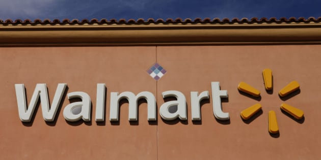 Wal-Mart Stores Inc. signage is displayed outside of a location ahead of Black Friday in Los Angeles, California, U.S., on Tuesday, Nov. 26, 2013. Wal-Mart Stores Inc. said Doug McMillon, head of its international business, will replace Mike Duke as chief executive officer when he retires as the world's largest retailer struggles to ignite growth at home and abroad. Photographer: Patrick T. Fallon/Bloomberg via Getty Images