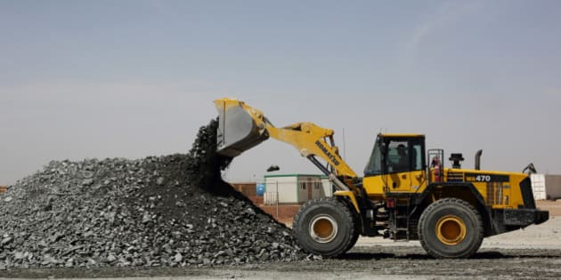 A Komatsu Ltd. front-loader bulldozer unloads gold-copper ore rocks taken from the underground pit at the Oyu Tolgoi copper-gold mine, jointly owned by Rio Tinto Group's unit Turquoise Hill Resources Ltd. and Erdenes Oyu Tolgoi LLC, in Khanbogd, the South Gobi desert, Mongolia, on Friday, June 7, 2013. Rio Tinto, the world's second-biggest mining company, is expected to start first shipments from its $6.6 billion copper-gold mine in Mongolia this month. Photographer: Tomohiro Ohsumi/Bloomberg via Getty Images
