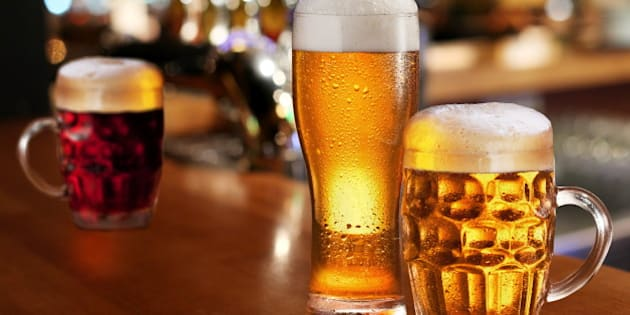 glass of light beer on a dark...