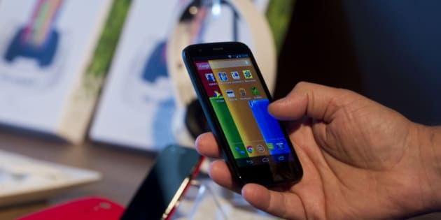 The new low cost smartphone of Motorola, 'Motorola Moto G', is displayed in Sao Paulo, Brazil on November 13, 2013. The smartphone, with dimensions 65.9mm W x 129.9mm H x 6.0 - 11.6mm D is equipped with a Qualcomm Snapdragon 400 with quad-core 1,2 GHz CPU, a 4.5-inch display and Android Operating System 4.3 and a suggested price of $ 179 USD.  AFP PHOTO / NELSON ALMEIDA        (Photo credit should read NELSON ALMEIDA/AFP/Getty Images)