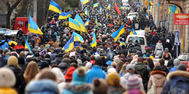 Thousands of demonstrators march in the western Ukrainian city of Lviv on December 2, 2013.  Ukrainian protesters on December 2 blockaded administrative buildings and camped on Kiev's central square in a bid to oust the government after police brutality and a row over an EU pact plunged the nation into its worst political crisis in a decade. Incensed by a crackdown on an opposition rally calling for the resignation of President Viktor Yanukovych and his government, more than 100,000 led politicians including world boxing champion Vitali Klitschko poured into the streets of Kiev and other Ukrainian cities on December 1.   AFP PHOTO / YURIY DYACHYSHYN        (Photo credit should read YURIY DYACHYSHYN/AFP/Getty Images)