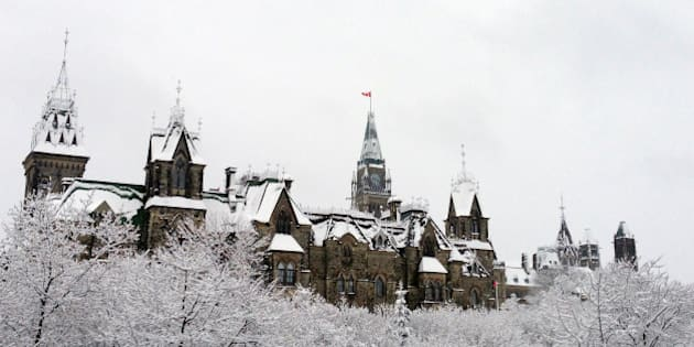 Canada's parliament was blanketed with snow overnight in Eastern Canada's first major snowfall of the winter in Ottawa, Ontario on November 27, 2013. A major winter storm that has dumped freezing rain and snow in the US southwest has killed at least 13 people in five states, US media reported.The storm is expected to continue east over the next several days, just as tens of millions of travelers are expected to hit the road or take to the skies ahead of the US Thanksgiving holiday on November 28, 2013. Images from the storm-hit region showed thick layers of ice on sidewalks and icicles dripping off leaves. The storm is forecast to bring substantial snow to the Appalachian mountains and New England, in the US northeast, by Wednesday, which is one of the biggest US travel days of the year, according to meteorologists at Accuweather.com.  AFP PHOTO/MICHEL COMTE        (Photo credit should read MICHEL COMTE/AFP/Getty Images)
