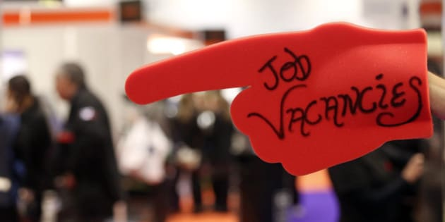 An exhibitor holds a giant red foam hand with the words 'Job Vacancies' at a stand during the Skills London job fair in London, U.K., on Friday, Nov. 22, 2013. Government figures show economic growth accelerated to 0.8 percent in the third quarter, the housing market is strengthening and about 60,000 jobs are being created every month, boosting taxes from company profits, payrolls, property purchases and sales. Photographer: Chris Ratcliffe/Bloomberg via Getty Images