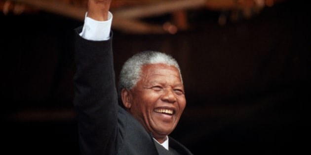 File photo dated 09/10/1993 of ANC President, Nelson Mandela, acknowledging the crowd at a rally in Glasgow after he had earlier received the Freedom of the City, the former South African president has died aged 95, the country's president Jacob Zuma said tonight.