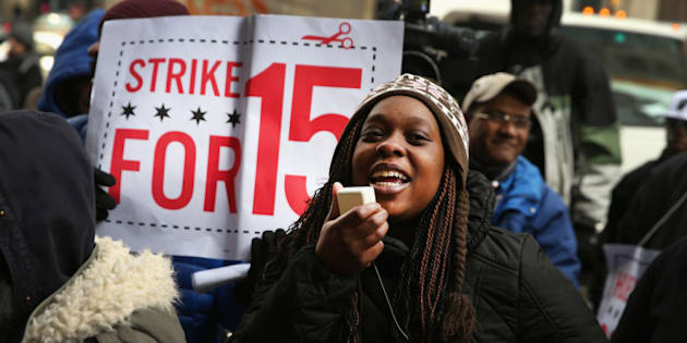 CHICAGO, IL - DECEMBER 05: Charde Nabors, a Sears employee, protests with fast-food and retail workers demanding higher pay outside a Sears store in the Loop on December 5, 2013 in Chicago, Illinois. Organizers have called for a one-day labor walkout at fast-food restaurants and retail stores and demonstrations in 100 cities.  (Photo by Scott Olson/Getty Images)