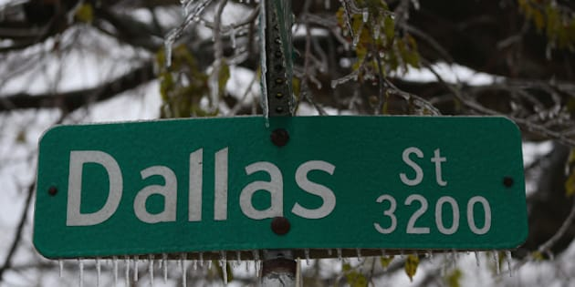 DALLAS, TX - DECEMBER 06:  Icicles form on a Dallas street sign on December 6, 2013 in Dallas, Texas.  The ice storm that has hit North Texas has left over 250,000 residents and businesses without power and has led to more than 1,700 flight delays and cancellations across the country. (Photo by Ronald Martinez/Getty Images)