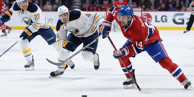 MONTREAL, QC - DECEMBER 7: Tomas Plekanec #14 of the Montreal Canadiens, controls the puck while being challenged by Jamie McBain #4 and Matt D'Agostini #27  of the Buffalo Sabres during the NHL game on December 7, 2013 at the Bell Centre in Montreal, Quebec, Canada. (Photo by Francois Lacasse/NHLI via Getty Images)
