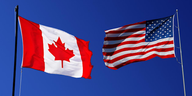 canadian and usa flag on blue...
