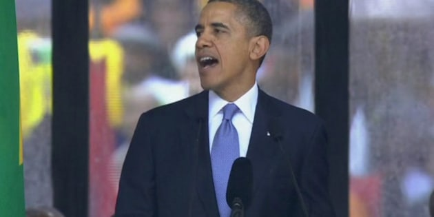 In this image from TV, US President Barack Obama speaks to the assembled crowds at the FNB Stadium in Soweto, South Africa, in the rain for a memorial service for former South African President Nelson Mandela, Tuesday Dec. 10, 2013.  Hundreds of foreign dignitaries and world heads of states gather Tuesday with thousands of South African people to celebrate the life, and mark the death, of Nelson Mandela who has became a global symbol of reconciliation. (AP Photo/SABC Pool)