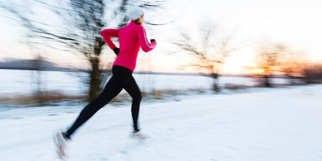 young woman running outdoors on ...