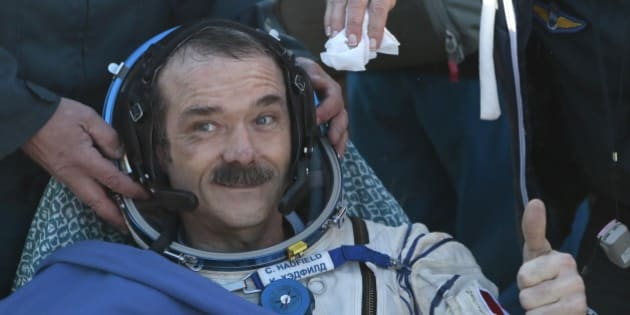Canadian spaceman Chris Hadfield  gives a thumb up shortly after the landing aboard the Russian Soyuz space capsule some 150 km (90 miles) southeast of the town of Zhezkazgan in central Kazakhstan on May 14, 2013. US astronaut Tom Marshburn, Canadian spaceman Chris Hadfield  and Russian cosmonaut  Roman Romanenko returned today  to Earth aboard a Russian Soyuz-TMA capsule after a half-year mission to the International Space Station, Moscow mission control said. AFP PHOTO / POOL /MIKHAIL METZEL        (Photo credit should read MIKHAIL METZEL/AFP/Getty Images)