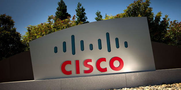 Cisco Systems Inc. signage is displayed outside of the company's headquarters in San Jose, California, U.S., on Tuesday, July 12, 2011. Cisco Systems Inc., the largest networking-equipment company, may cut as many as 10,000 jobs, or about 14 percent of its workforce, to revive profit growth, according to two people familiar with plans. Photographer: David Paul Morris/Bloomberg via Getty Images