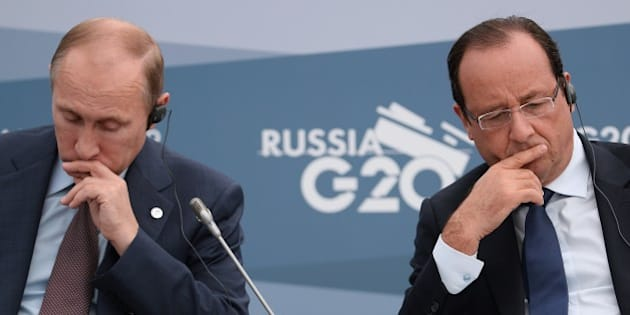 SAINT PETERSBURG - SEPTEMBER 06:  President of the Russian Federation Vladimir Putin, (L) and President of France, Francois Hollande attend a meeting with Business 20 and Labour 20 representatives during the G20 summit on September 6, 2013 in St. Petersburg, Russia. Leaders of the G20 nations made progress on tightening up on multinational company tax avoidance, but remain divided over the Syrian conflict as they enter the final day of the Russian summit. (Photo by  Alexey Filippov /Host Photo Agency via Getty Images)